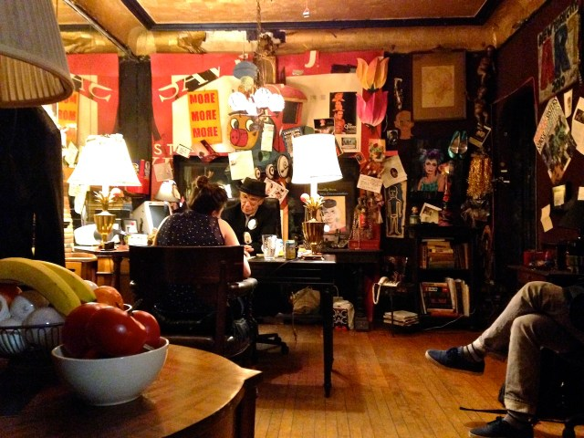 Flawless Sabrina reading Tarot cards in her apartment (photo by the author for Hyperallergic)