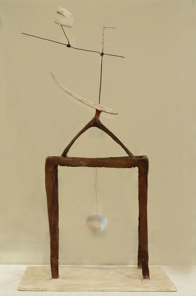 """Alberto Giacometti, """"Hour of the Races"""" (1930): """"A picture of a flower on a glass table, or possibly a black and white vase on a wall with a plant. It stirs up a memory of a vase sitting on top of a wooden roof."""""""