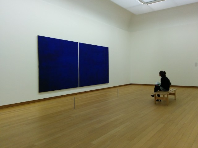 """A visitor at the Stedelijk Museum in Amsterdam takes in Barnett Newman's 1951 painting """"Cathedra"""" (Image via Wikimedia)"""