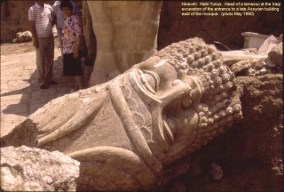 A large a bull-man sculpture being excavated at Niveneh in 1990 (photo via Wikimedia Commons)