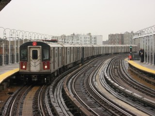 A 2 train on the elevated tracks in the Bronx in 2007 (photograph by Adam E. Moreira, via Wikimedia)