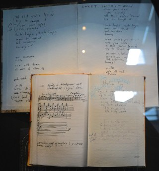 """Some of Bjork's notebooks in the """"Songlines"""" portion of the exhibition (photo by Jillian Steinhauer/Hyperallergic)"""