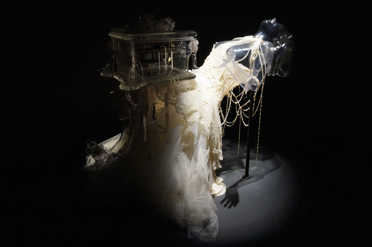 "Alexander McQueen, ""Pagan Poetry"" Dress (2001), and Matthew Barney, 'Verspertine' Music Box (2001) and 'Vespertine Live' Shoes (2001) (photo by Jillian Steinhauer/Hyperallergic)"