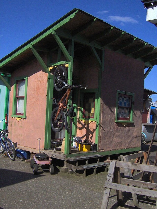 This adobe structure is one of several tiny houses built in Dignity Village, a homeless community in Portland, Oregon that was one of the earliest tiny house villages when it opened in 2001. The 120-square-foot space is constructed from mud and straw and clad in weatherproof adobe.