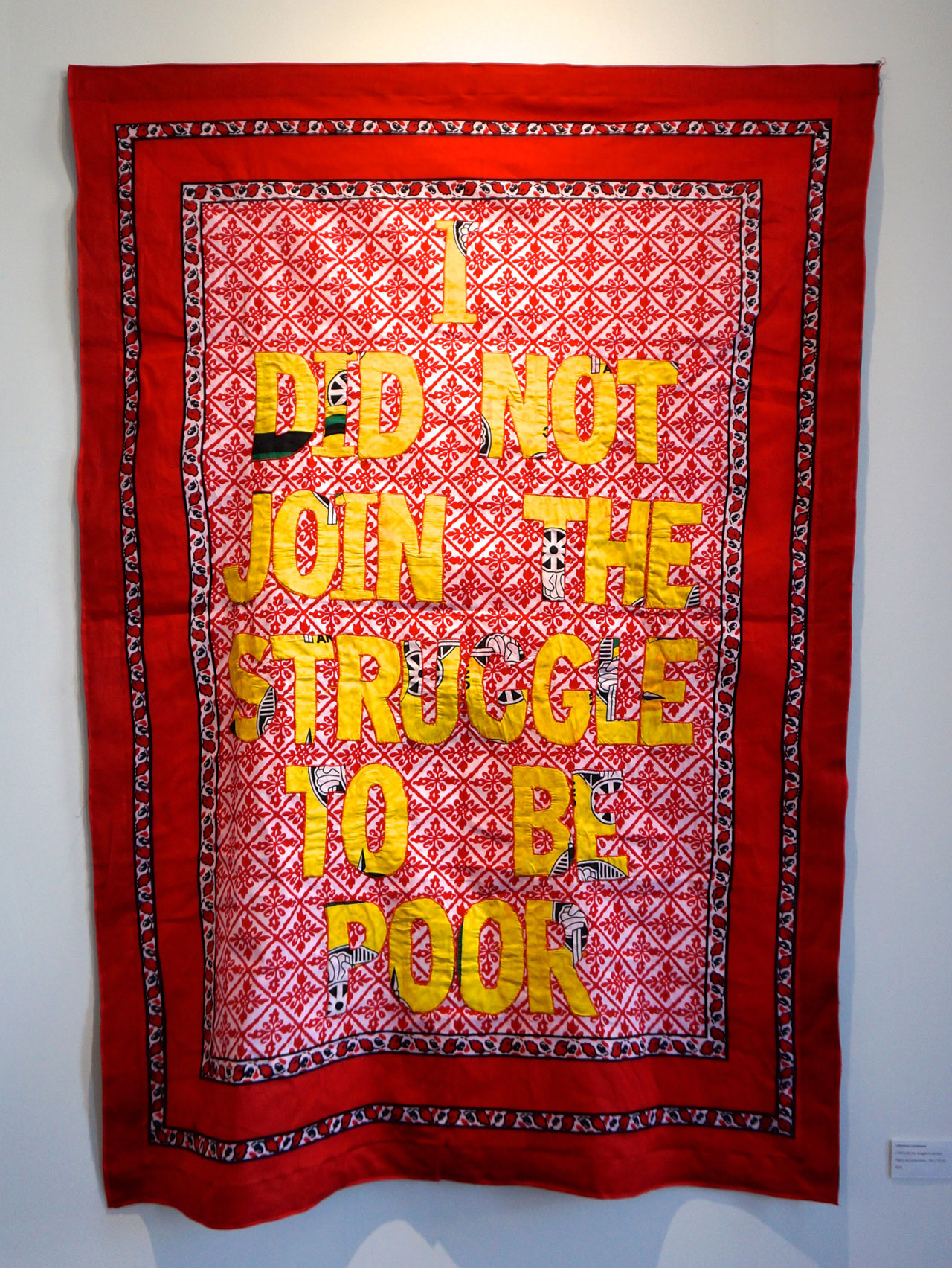"Lawrence Lemaoana, ""I didn't join the struggle to be poor"" (2015), fabric and embroidery, 155 x 110 cm, at Afronova's booth"