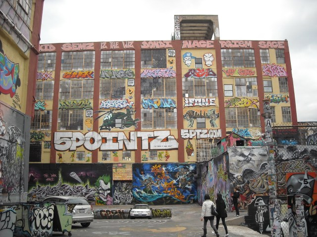 The rear entrance of 5Pointz in 2010 (photo by Eco84, via Wikimedia Commons)