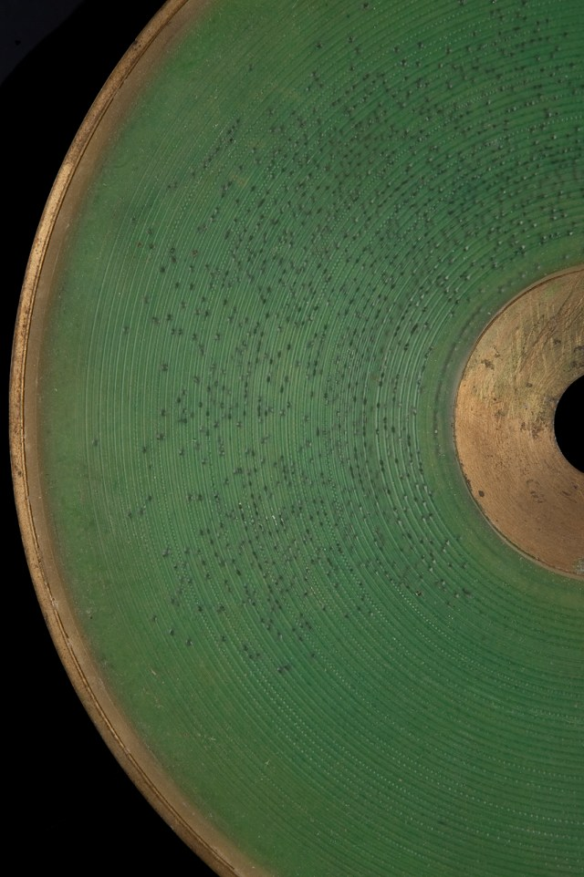 "Hamlet green wax disc (likely 1884-85). Content: Man reciting opening line's of Hamlet's ""To be, or not to be"" soliloquoy"