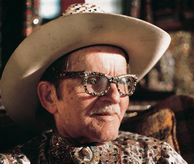 "The ""Original Rhinestone Cowboy,"" Loy Bowlin, in his Beautiful Holy Jewel Home, McComb, Mississippi (1990) (photo by Harrod Blank, courtesy John Michael Kohler Arts Center Artist Archives)"