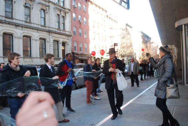 Former Cooper Union board of trustees chairman Mark Epstein walking past protesting students in 2012 (photo by Free Cooper Union, via Wikimedia Commons)