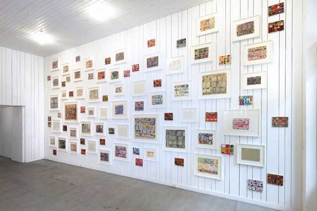 An installation view of 80 works on paper and canvas (1990) by Stanley Whitney