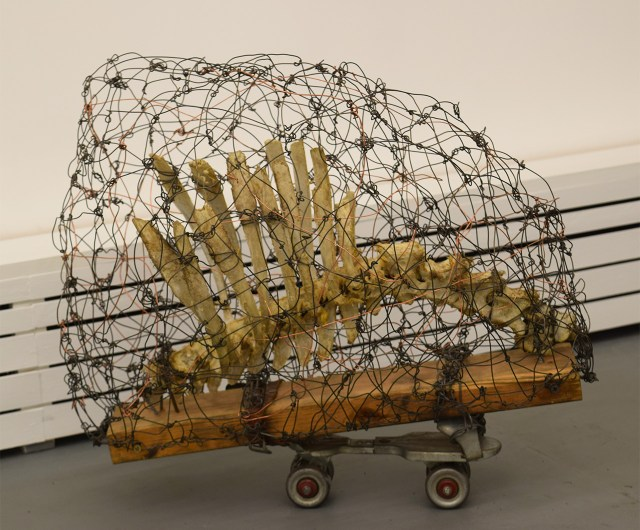 "Arthur Simms, ""Skunk"" (2011), roller skate, wire, bone, wood, screws"
