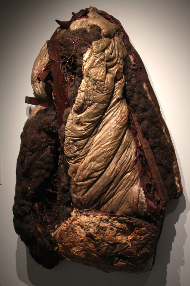 """Raphael Montañez Ortiz, """"Archeological Find #21: The Aftermath"""" (1961) destroyed sofa, wood, cotton, vegetable fiber, wire, and glue on wooden backing 84 x 54 x 24 Inches"""