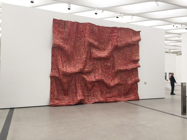 "El Anatsui, ""Red Block"" (2010), found aluminum and copper wire, 200 3/4 x 131 1/2 in."