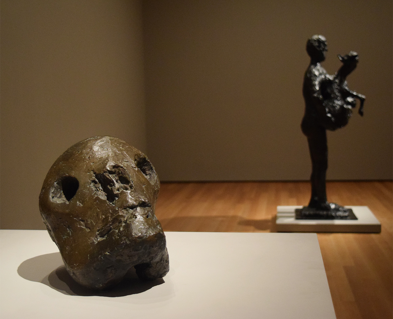 "Installation view of 'Picasso Sculpture' at the Museum of Modern Art with Pablo Picasso's ""Death's Head"" (1941) at left and ""Man with Lamb"" (1943) at right"