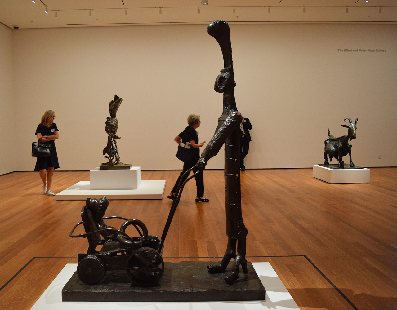 """Installation view of 'Picasso Sculpture' at the Museum of Modern Art with Pablo Picasso's """"Woman with a Baby Carriage"""" (1950–54) in the foreground"""
