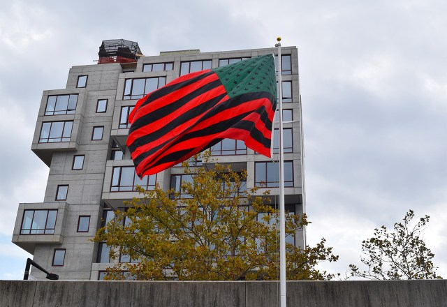 """David Hammons's """"African American Flag"""" (1990) flies in the courtyard of MOMA PS1. (all photos by the author for Hyperallergic)"""