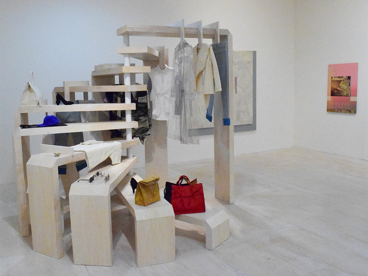 An installation and objects by Slow and Steady Wins the Race (left) and a painting by Seth Price (right)