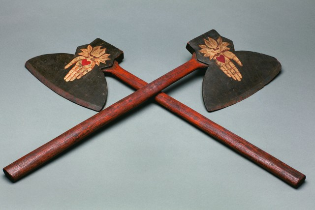 Pair of Odd Fellows axes (1870s), unidentified artist, carved wood with painted heart in hand decoration, each 28 × 8 × 1 in.