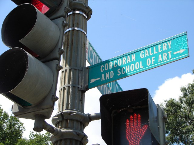 A sign pointing to the location of the old Corcoran Gallery and School of Art building. (photo by J B/Flickr)