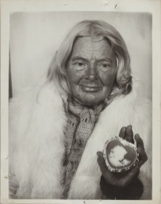 Lee Godie, untitled (in white fur stole with heart-shaped cameo), n.d., gelatin silver print, 4¾ x 3¾ in. (click to enlarge)