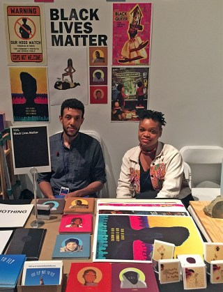Erin Christovale (right) at the Black Lives Matter booth
