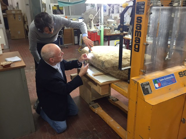 Scientists examining the Etruscan stele (courtesy Mugello Valley Project)