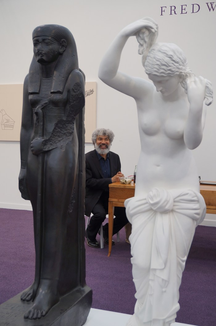 """Fred Wilson sandwiched between his """"The Mete of the Muse"""" (2006)"""