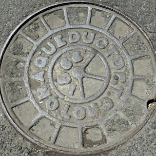 One of the oldest-known manhole covers, located on Jersey Street in Soho, for the Croton Aqueduct system