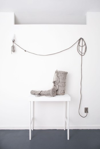 """Maria Hupfield, """"Bright Ideas Basket Installation with Instructions"""" (2016), wall installation with table, industrial felt, small jingle bells, thread, and polyfil, dimensions variable"""