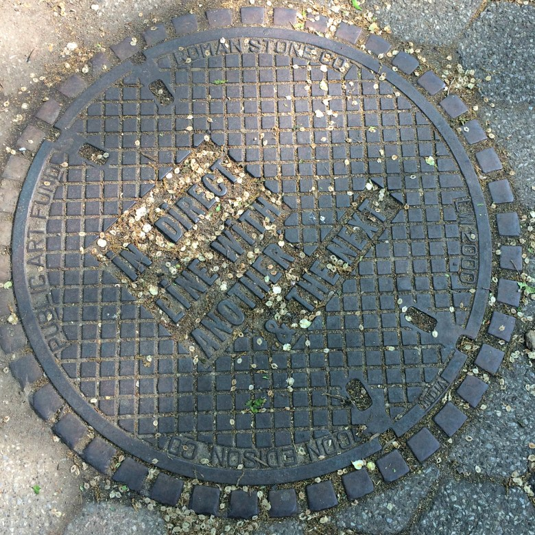 Manhole cover designed by Lawrence Weiner in Union Square