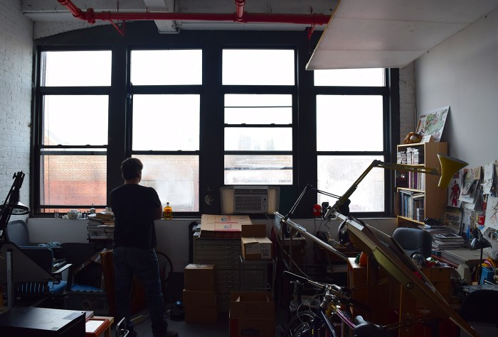 Dean Haspiel looks out the window of his studio at 112 2nd Avenue in Gowanus