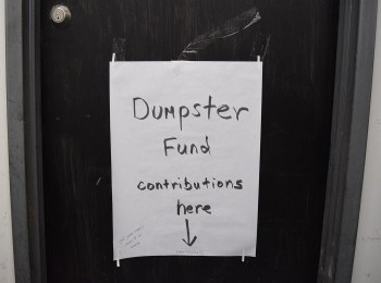 A sign directing tenants of 112 2nd Avenue to pitch in for a dumpster