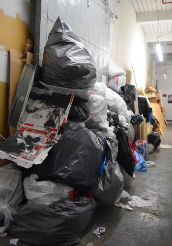 Trash fills a hallway at 112 2nd Avenue in Gowanus