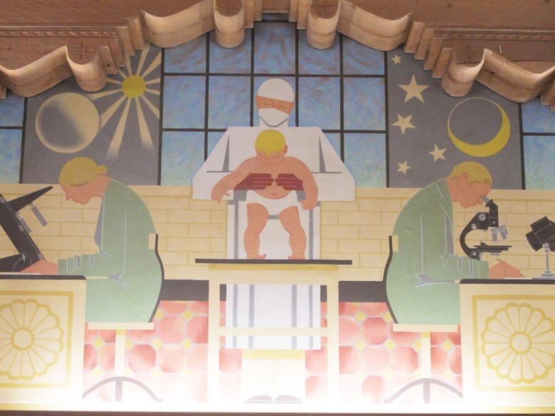 The third library mural, showing white scientists and a baby