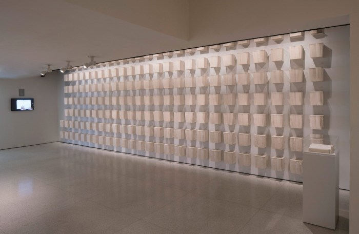 "Joana Hadjithomas and Khalil Joreige, ""Latent Images"" (2015), 354 copies of printed artist's book, 177 metal shelves, and color video, with sound, 120 min, Solomon R. Guggenheim Museum, New York, Guggenheim UBS MAP Purchase Fund 2015.88"