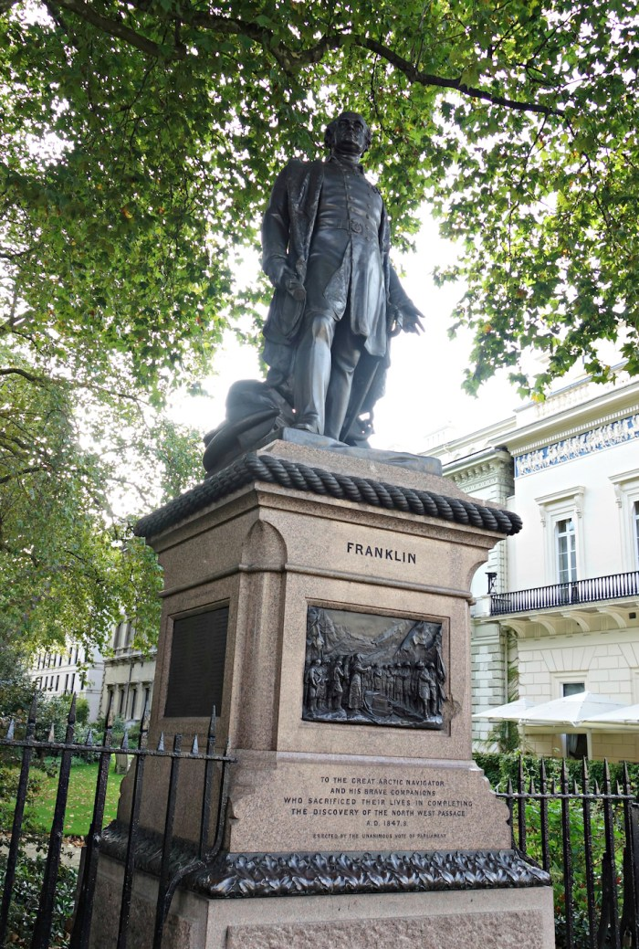 The Franklin Expedition Monument (1866) by Matthew Nobel in Waterloo Place, London (photo by the author for Hyperallergic)