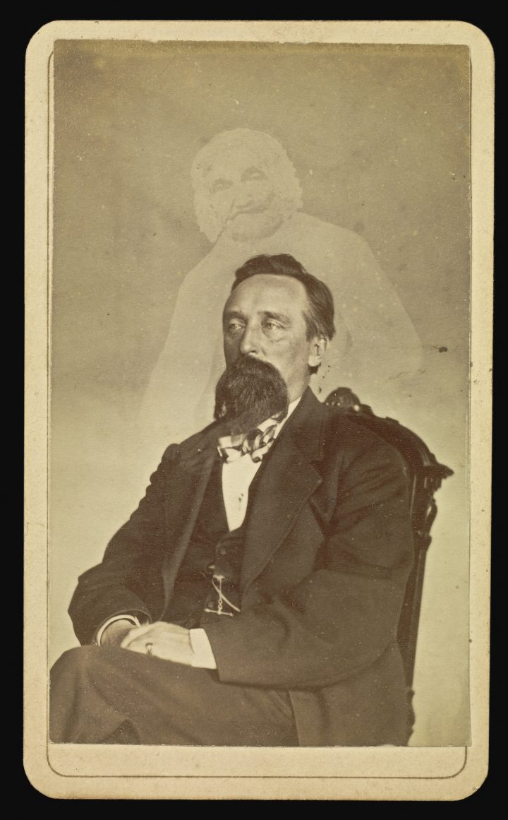 William H. Mumler's photograph of John J. Glover with a ghost (1862-75) (via J. Paul Getty Museum/Wikimedia)
