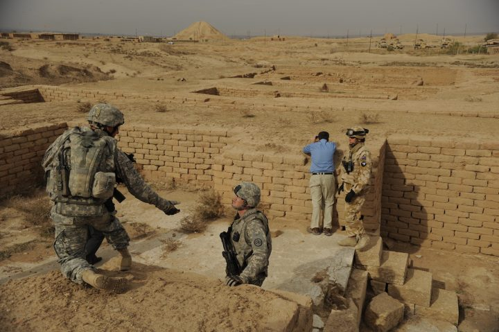 Members of the Provincial Reconstruction Team and UNESCO representatives visit Nimrud, whose ziggurat looms in the distance, in 2008. (photo by Staff Sgt. JoAnn Makinano, via Wikimedia Commons)