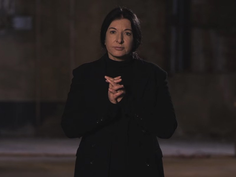 """Marina Abramović describing her """"Slow Motion Walk"""" technique inside what was to be the Marina Abramović Institute in Hudson, New York. (screenshot by the author via YouTube)"""