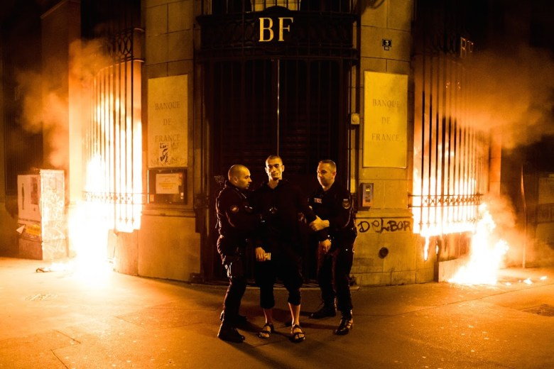 """Petr Pavlensky being detained at the scene of his piece, """"Lighting,"""" in Paris. (all photos courtesy the artist and Oksana Shaligyna)"""