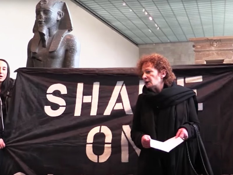 Nan Goldin at Saturday's PAIN Sackler protest in the Metropolitan Museum's Sackler Wing (screenshot by the author via YouTube)