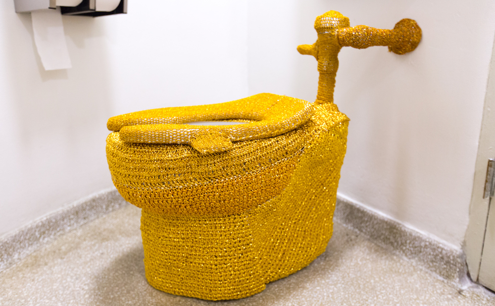 Someone Yarn Bombed A Guggenheim Museum Toilet With Gold Crochet