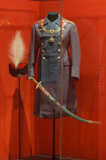 A 19th-century military uniform on view in <em srcset=