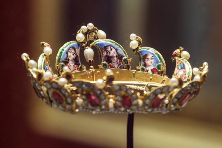 A 19th-century decorated crown on view in <em srcset=