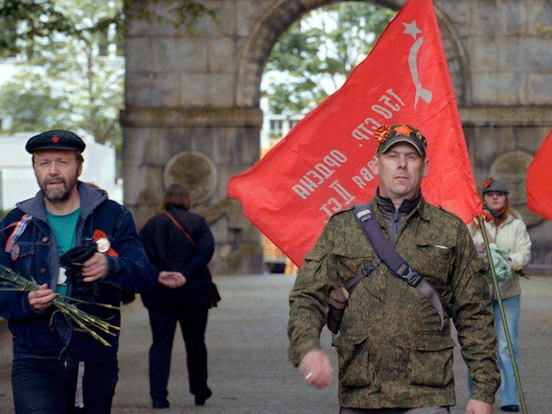 Flags, red carnations, and St. George ribbons are the accouterments of the revelers in Victory Day (2018)