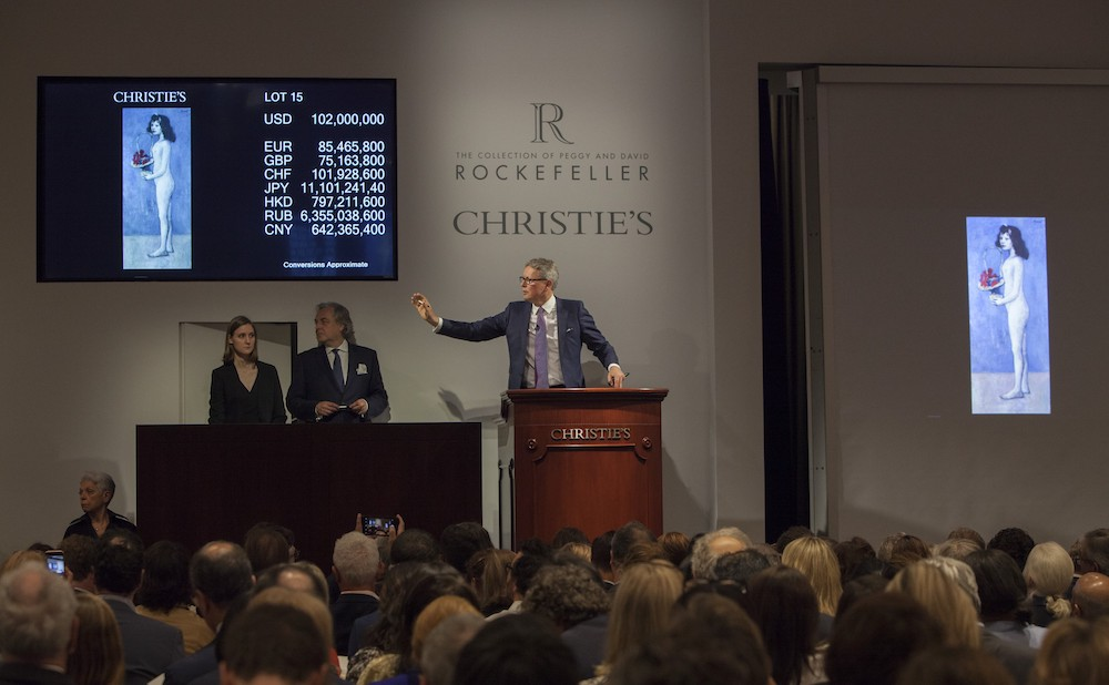 "Christie's auctioneer Jussi Pylkkänen soliciting bids on Picasso's ""Fillette à la corbeille fleurie"" at the May 9 Rockefeller collection evening sale (all images courtesy Christie's)"
