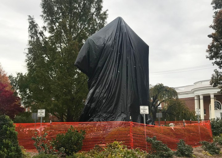 The Robert E. Lee Monument in Charlottesville, Virginia, wrapped in plastic following deadly protests (photo by Benjamin Sutton/Hyperallergic)