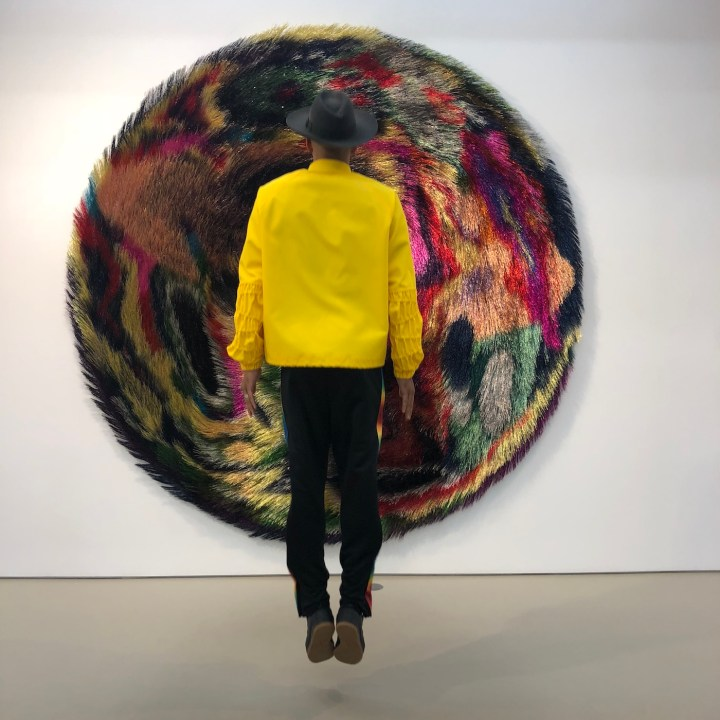 Swizz Beatz in front of a work from Nick Cave's <em srcset=