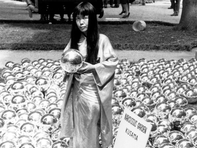 "Yayoi Kusama with ""Narcissus Garden"" (1966) installed in Venice Biennale, Italy, 1966 (©YAYOI KUSAMA, courtesy David Zwirner, New York; Ota Fine Arts, Tokyo/Singapore/Shanghai; Victoria Miro, London/Venice)"