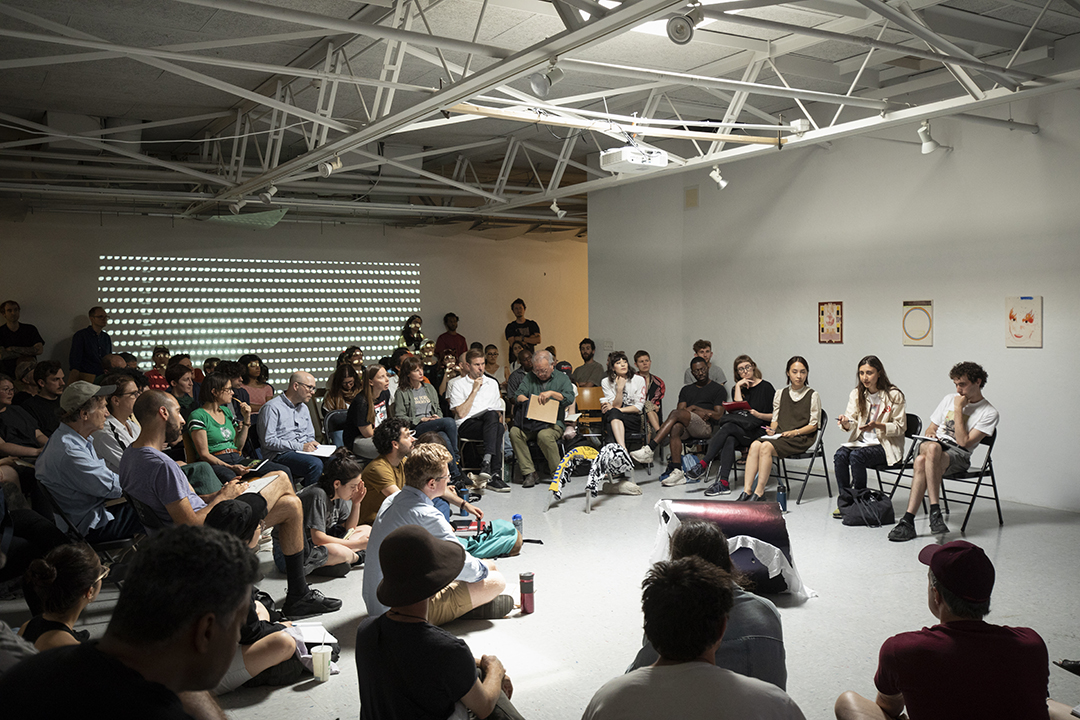 Third year student Marina Xenofontos presents her work to students and faculty, summer 2018. Photo: Pete Mauney